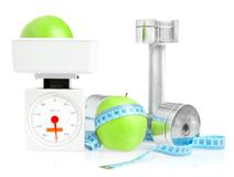 Dumbbells and apple. Royalty Free Stock Photography