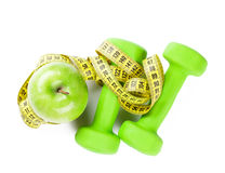 Dumbbells, apple and tape measure Stock Photo