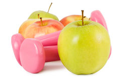 Dumbbells and apples Stock Images