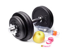 Dumbbells, apples, a bottle and centimeter Stock Images