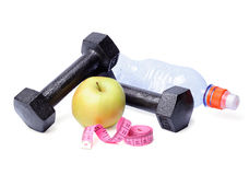 Dumbbells, apples, centimeter and bottle Royalty Free Stock Image