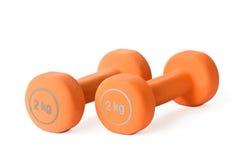 Dumbbells arancioni Fotografie Stock Libere da Diritti