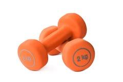 Dumbbells arancioni Immagine Stock