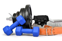 Dumbbells with belt and gloves Stock Photo