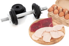 Dumbbells and Body Building Food Stock Photography