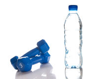 Dumbbells and bottle of fresh water Royalty Free Stock Images