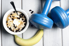 Dumbbells and bowl with yogurt Stock Image