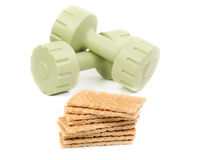 Dumbbells and bread Stock Photography