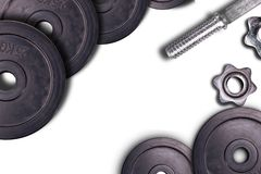 Dumbbells on carbon background. Dumbbells and weights are lying on the floor in the gym. Barbell set and gym equipment. Metal royalty free stock photo