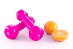 Dumbbells cor-de-rosa com laranja Fotografia de Stock