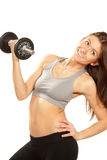 Dumbbells di weightlifting di allenamento della donna di forma fisica Immagini Stock