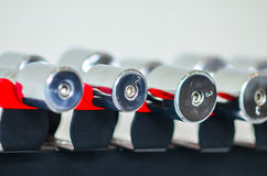 Dumbbells of different scales lie on the sports Stock Photo