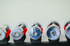 Dumbbells of different scales lie on the sports Royalty Free Stock Photography