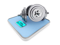 Dumbbells on Digital Bathroom Weight Scale Royalty Free Stock Photography