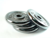 Dumbbells discs. Isolated chrome plated dumbbells discs Royalty Free Stock Photos
