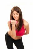 Dumbbells do exercício do instrutor da mulher da aptidão na ginástica Imagem de Stock Royalty Free