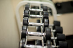 Dumbbells for exercise in Fitness Room. Royalty Free Stock Photos