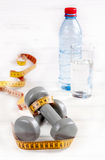 Dumbbells and exercise. And water royalty free stock photography