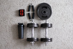 Dumbbells with expander and shaker Stock Photos