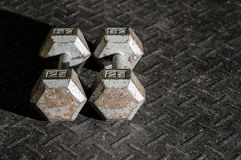 Dumbbells on the floor Royalty Free Stock Images