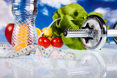 Dumbbells, fresh food and measure tape Royalty Free Stock Photo