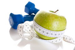 Free Dumbbells, Fresh Green Apple And Measure Tape Stock Image - 14079491