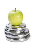 Dumbbells  and green apple  onr white background Royalty Free Stock Images