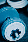 Dumbbells on gym floor Royalty Free Stock Images