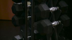 Dumbbells in the gym - muscle training. Weight stock video