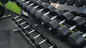 Dumbbells in the gym stock video footage