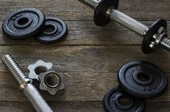 Dumbbells gymnastic on a wooden background 2 stock image