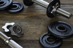 Dumbbells gymnastic on a wooden background 4 royalty free stock images