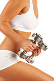 Dumbbells in hand Stock Images