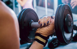 Dumbbells in the hands Stock Image