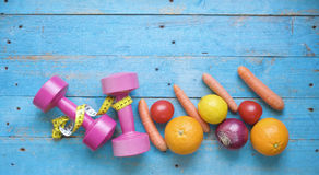 Dumbbells and healthy food Royalty Free Stock Photography