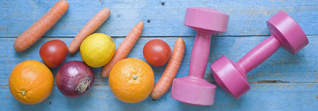 Dumbbells and healthy food Royalty Free Stock Photo