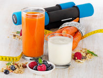 Dumbbells and healthy fresh food - health and diet concept Stock Photos