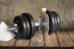 Dumbbells. Healthy Lifestyle Water Water Bottle Weights Body Conscious Barbell Royalty Free Stock Photo