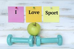 Dumbbells and I Love Sport Notes stock photo
