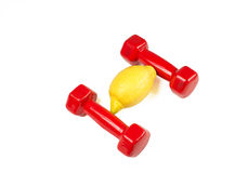 Dumbbells and lemon  on white background Royalty Free Stock Photos