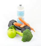 Dumbbells made of broccoli with water bottle, carrots and green a Royalty Free Stock Photography