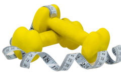 Dumbbells and measure. Dumbbells and meter  on white Royalty Free Stock Images