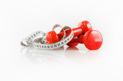 Dumbbells and measuring tape Royalty Free Stock Photography