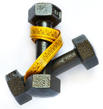 Dumbbells with measuring tape isolated Stock Photography