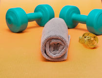 Dumbbells and measuring tape  on white background Royalty Free Stock Photo