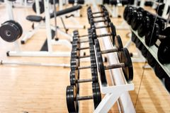 Dumbbells in modern sports club, gym or fitness center Royalty Free Stock Images