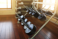 Dumbbells in modern sports club. Weight training equipment Stock Photos