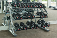 Dumbbells in modern sports club Stock Images