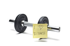 Dumbbells with note. Free weights with a note in front of white Stock Photos