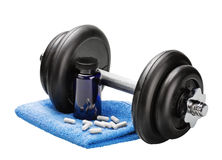 Dumbbells and pills Royalty Free Stock Images